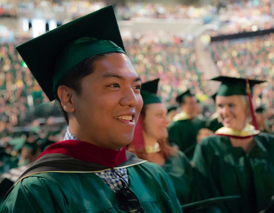 A male master's graduate at commencement