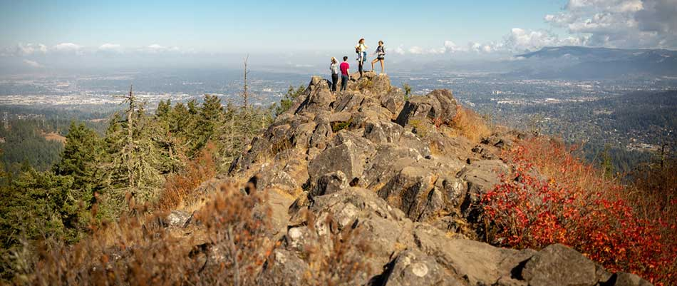 People on top of Spencer Butte overlooking Eugene